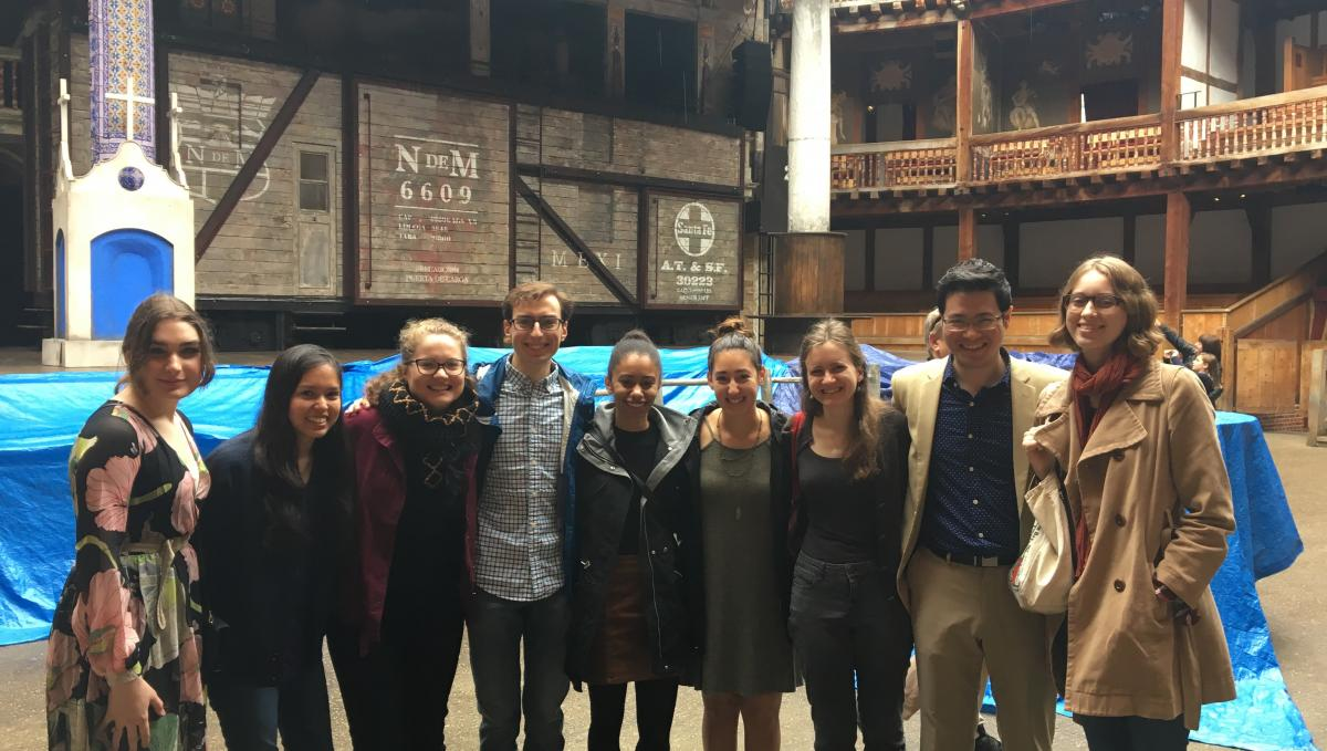 Junior seminar students in front of the stage at the Globe Theatre